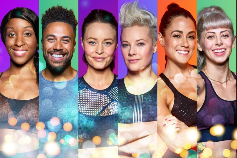 fitness coaches with a glittery background