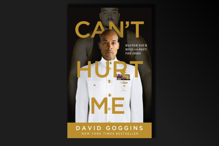 book cover art with the title: Can't Hurt Me text over a man standing in a white uniform