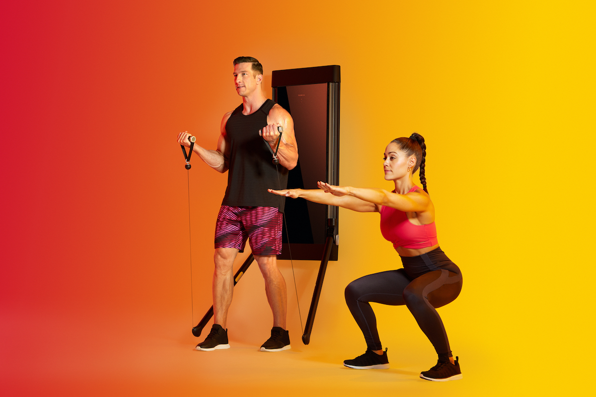 a man and a woman exercising together against a yellow background