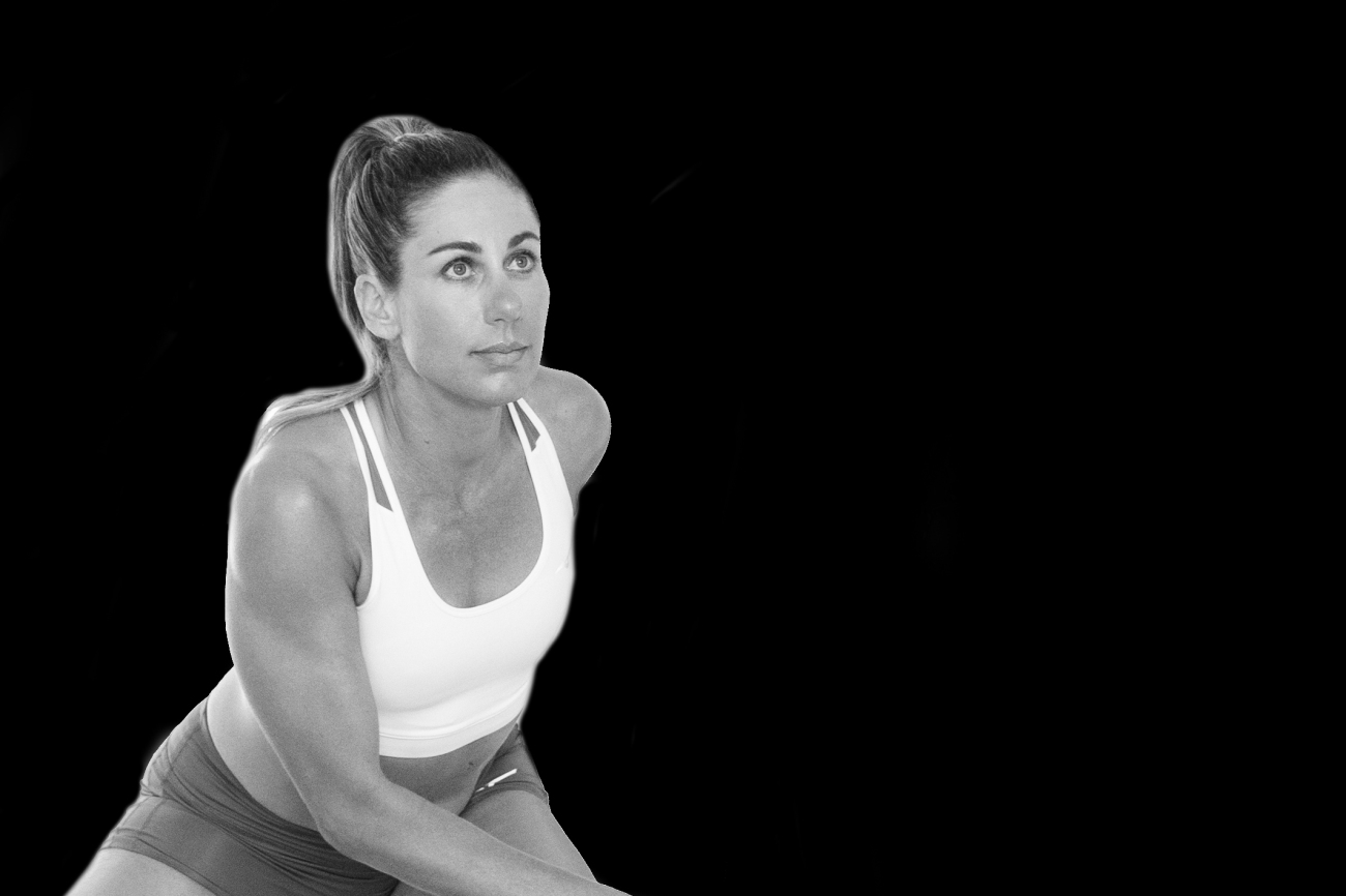 black and white image of a woman working out