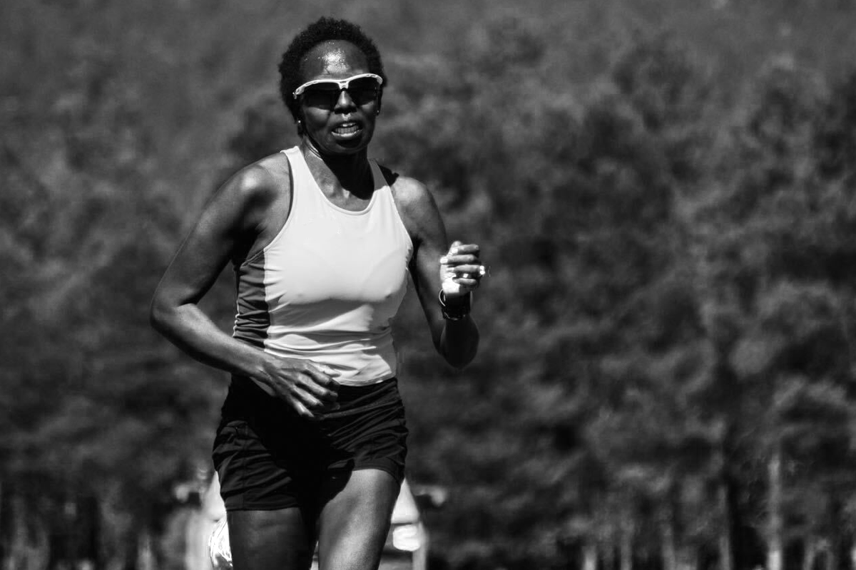 black and white image of a woman running her marathon