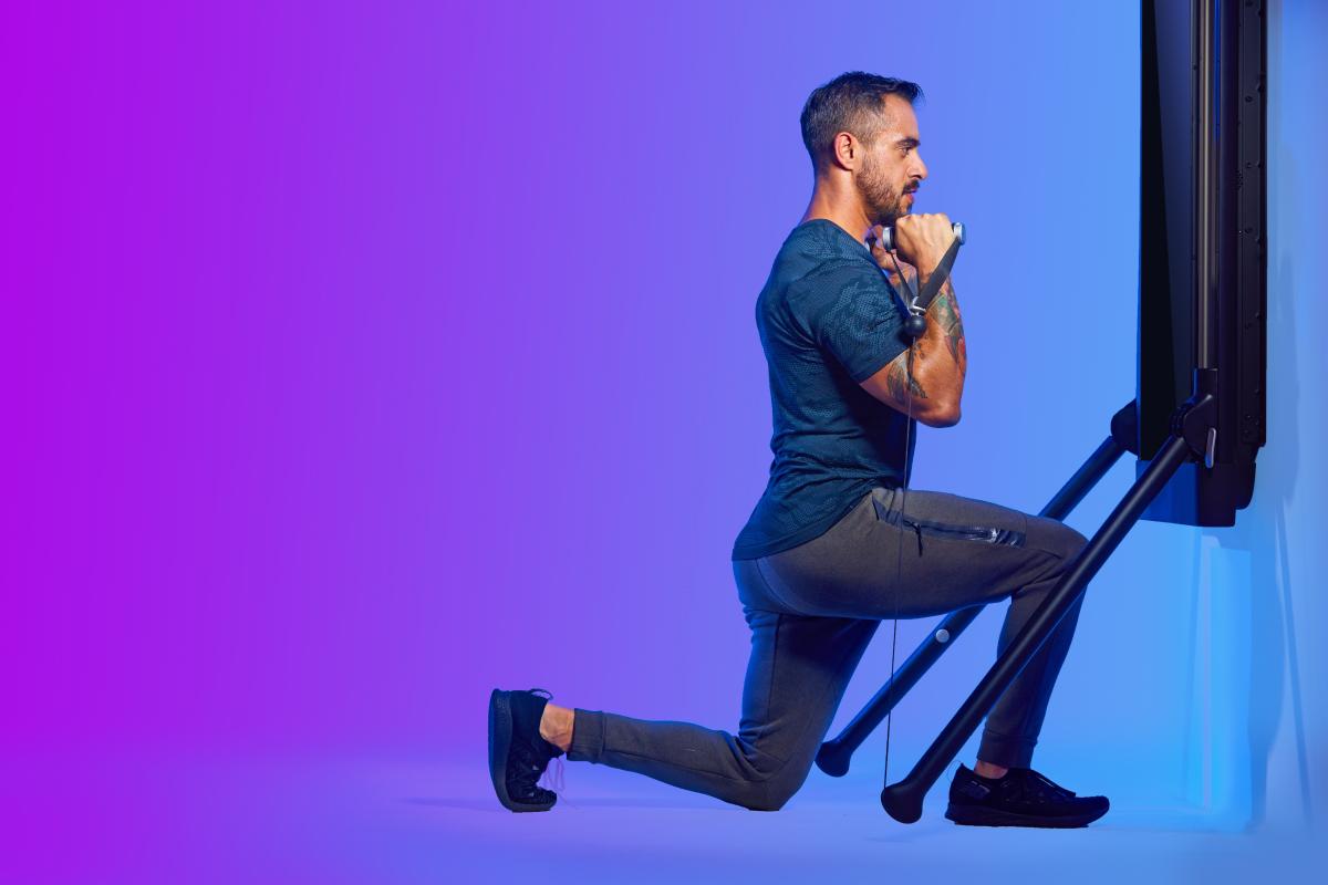 a man doing a split squat on tonal
