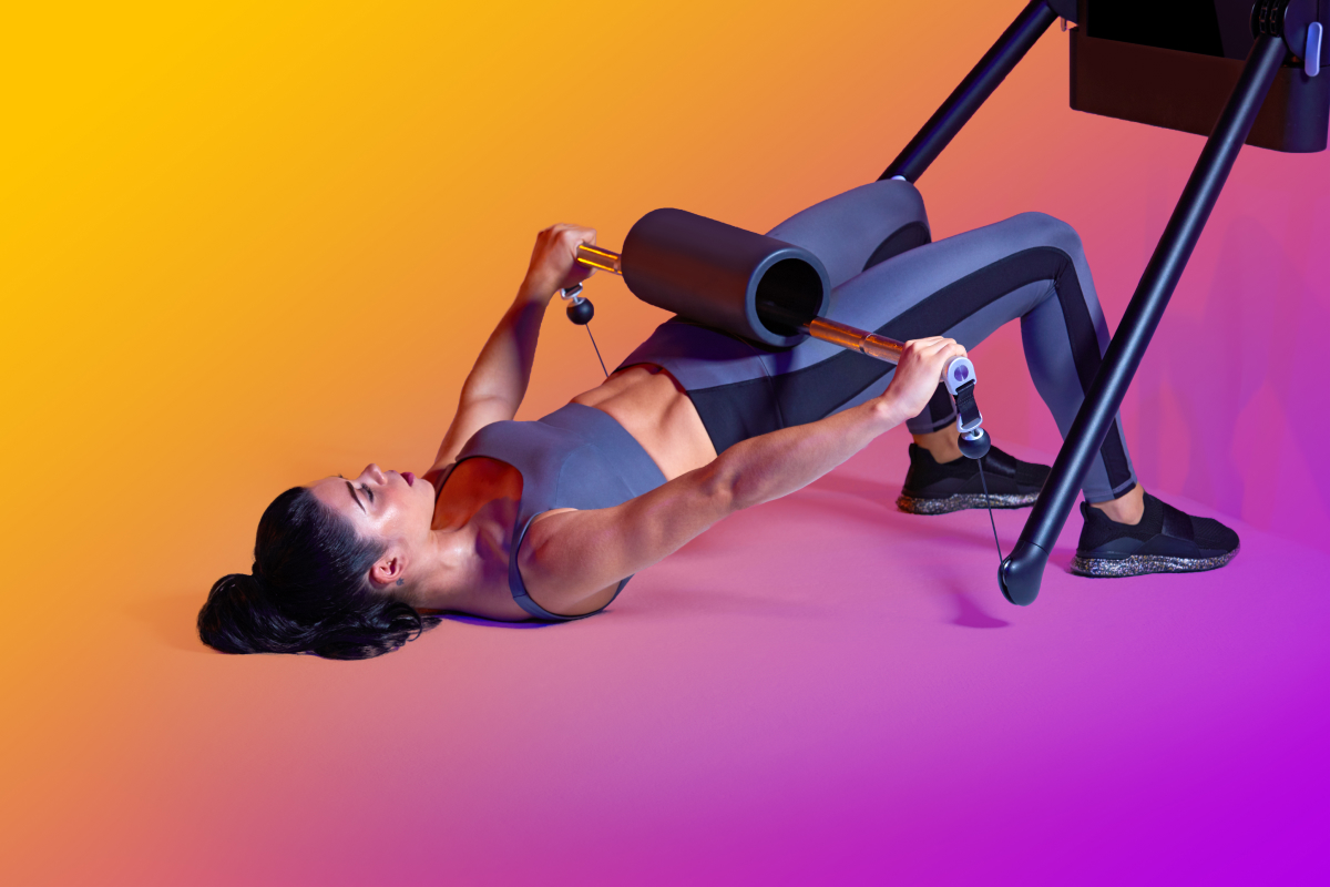 image of a woman doing a barbell glute bridge