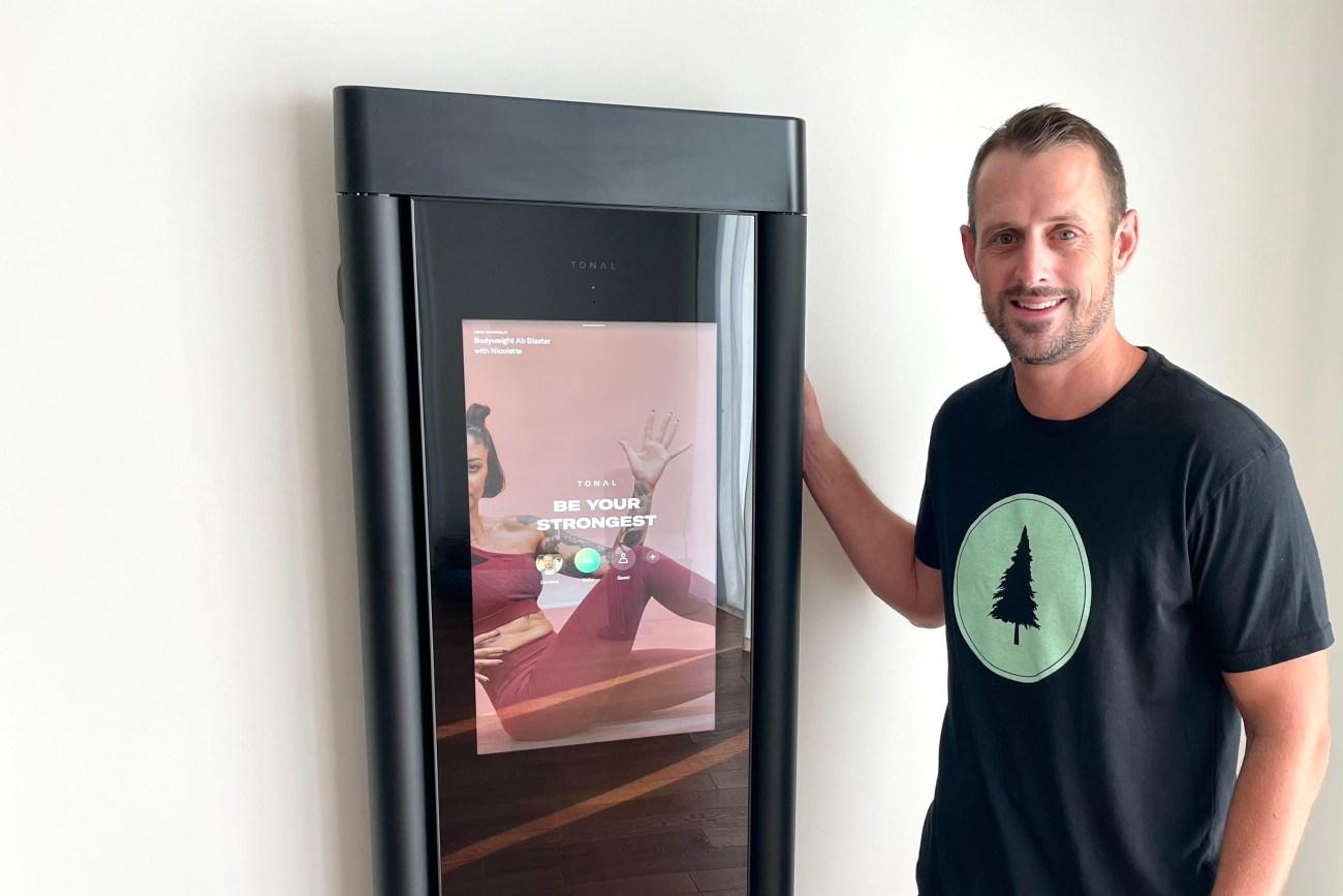 man standing next to tonal smiling
