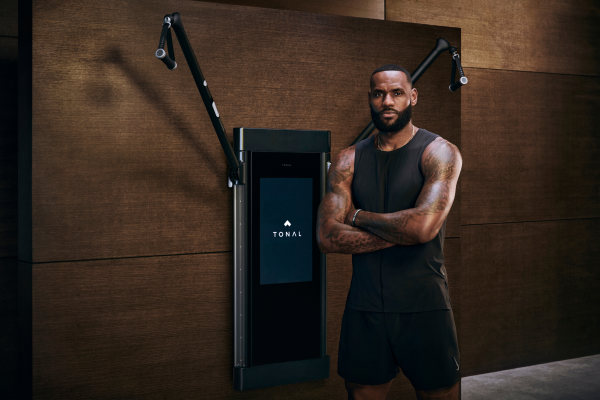 LeBron James standing in front of Tonal to demonstrate his new partnership