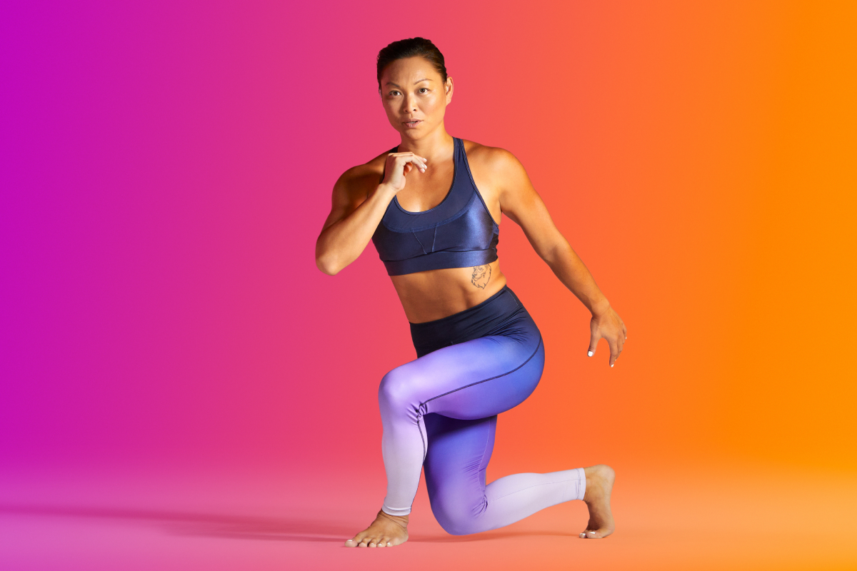 a woman does barefoot training while lunging